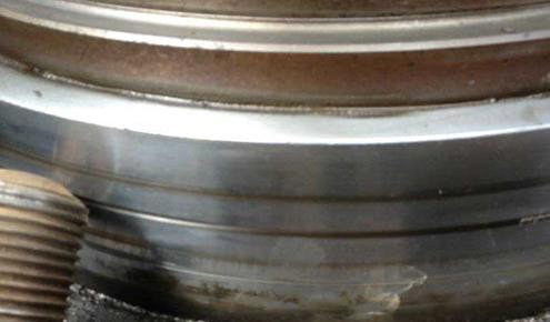 水泥生料磨辊轴磨损修复